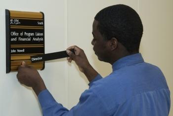 Technician replacing nameplate
