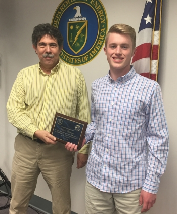 David Adler presents Cameron Niemeyer with plaque of appreciation