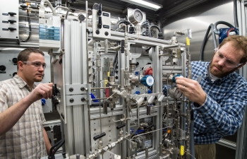 NREL has verified a very efficient gasification process for converting biomass to a high-octane gasoline blendstock.  (Photo by Dennis Schroeder, NREL)