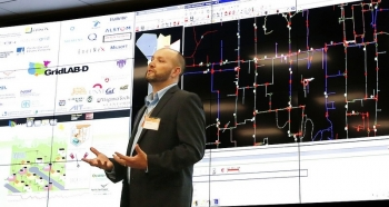 PNNL researcher Jason Fuller described PNNL power grid research at the new Systems Engineering Building.  Courtesy of Pacific Northwest National Laboratory.