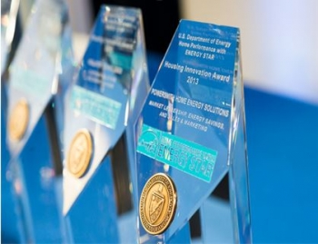 Photo of Housing Innovation Awards trophies.