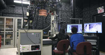 Two researchers look at a computer screen.