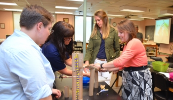 Teachers participate in a hands-on science activity as part of the 2017-2018 JSAT Program.