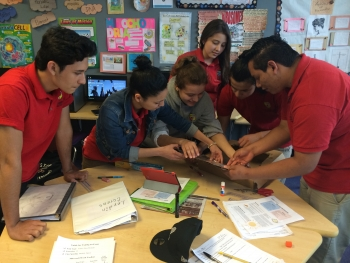 The LAYC Career Academy builds a solar oven from a pizza oven.