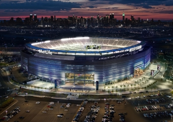 Photo of MetLife Field at night with the lights shining.
