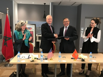 David Huizenga, NNSA's Principal Assistant Deputy Administrator, and Dr. Khammar Mrabit, Director General of the Moroccan Agency for Nuclear and Radiological Safety and Security, sign a new memorandum of understanding in Rabat, Morocco.