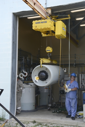 Workers removed the two 2,000-pound containers of liquid chlorine at the X-611 Water Treatment Facility at the Portsmouth Gaseous Diffusion Plant.