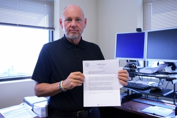 Frank Salaman, BNI manager of procurement and subcontracts for the WTP Project, displays EM's letter recognizing the company for its more than $7.8 million in federal cost savings.