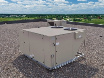 Photo of a rooftop unit on a large commercial of residential building roof.