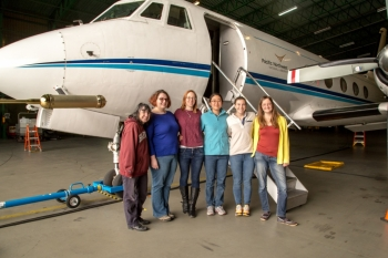 Female ARM Aerial Facility staff and instrument mentors during ACE-ENA gather in front of ARM's Gulfstream-159 (G-1) research aircraft during the winter 2018 intensive operational period.