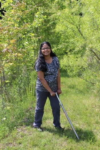 Picture of Sindhu Jagadamma at work in the field.