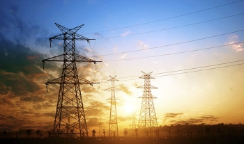 Transmission lines spanning in the sunset