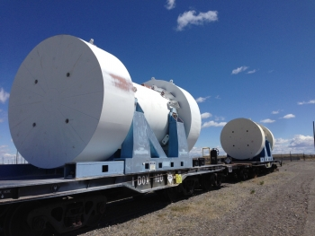 Photo of a transportation cask against a bright clear sky.