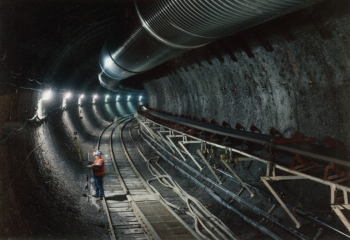 View of the first curve in the main drift of the Exploratory Studies Facility in October 1995