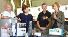 British Columbia Energy Minister Bill Bennett, British Columbia 35th Premier Christy Clark, and BC Hydro's Gary Hamer and Joanna Sofield demonstrate the Energy-Saving Kit.