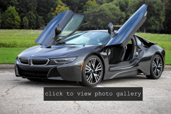 An electric BMW with its doors open.