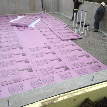 Doe tour of zero eco2 by brightleaf homes department of for Foundation blanket wrap insulation