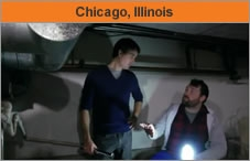 "Two men talking near a duct system, with the words, ""Chicago, Illinois."""