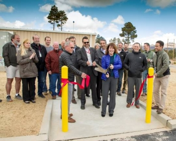 Staff from NNSA and Los Alamos National Laboratory open the new shock physics research facility last month. Sheila Feddis, program manager from the Office of Safety, Infrastructure and Operations cuts the ribbon.