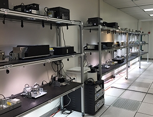 LED downlights in a long-term test rack.
