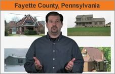 "A man facing the camera with images of houses behind him, and the words, ""Fayetteville, Pennsylvania."""