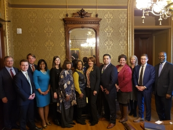Officials from the city of Flint, Michigan, the DOE and the White House in a group photo after the meeting.