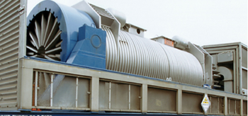 A typical spent nuclear fuel cask sitting on a railcar.
