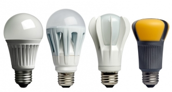 Four different varieties of LED light bulbs lined up in a row.