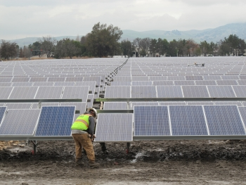 A worker puts the final touches on the Livermore Solar Farm.
