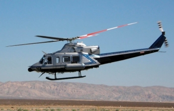 """Twin-engine Bell 412 helicopter operated by NNSA in Nevada. AMS teams fly """"low and slow"""" to survey large areas and provide real-"""