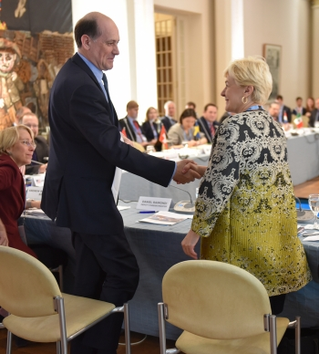 Acting Assistant Secretary of State for Arms Control, Verification and Compliance, Anita Friedt, shakes hands with Deputy Foreig