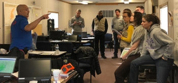 DART Field Monitoring Specialist, John Aloi/BNL, (second from left) briefs the DART on radiation dosimetry.