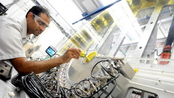 Argonne physicist Mahalingam Balasubramanian loads an in situ lithium-ion battery into the low-energy resolution inelastic X-ray (LERIX) system at the Advanced Photon Source.
