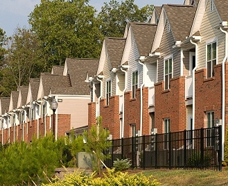 Profile photo of a row of townhomes.