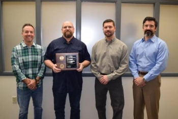 OST Vulnerability Analysis Team, left to right, Chad Ouellette and Jeff Beck of OST; and Derek Farr and Charles Hedrick of Sandia National Laboratories. Not pictured: Scott Rogers and Carlos Montanez of OST.