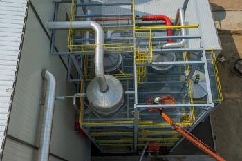 Pretreating biomass