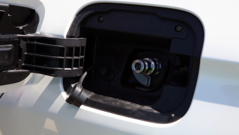 The hydrogen fuel nozzle locks on to the fuel receptacle (above) before fueling begins.