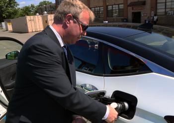 A man fills up a fuel cell tank.