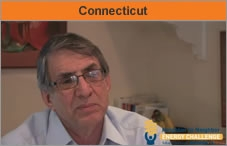 """Head-and-shoulders shot of a man facing the camera, with the word """"Connecticut."""""""