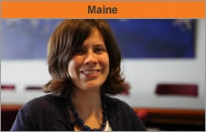 """Head and shoulders of a woman facing the camera and smiling, with the word """"Maine."""""""