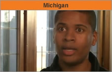 """Head and shoulders of a man turned toward the camera, with the word """"Michigan."""""""