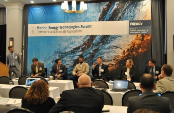 Six men and one woman on stage at the Marine Energy Technologies Forum.