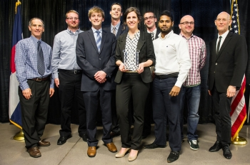 This photo shows one of the Grand Winner teams at the 2014 Student Design Competition, holding their trophy.