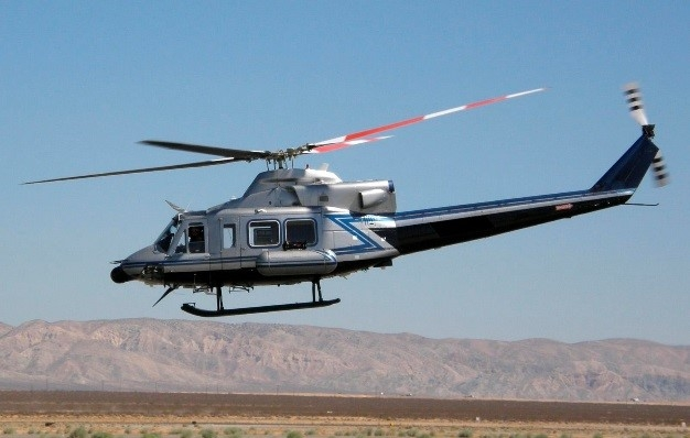 "Twin-engine Bell 412 helicopter operated by NNSA in Nevada. AMS teams fly ""low and slowâ€\u9dto survey large areas and provide real-"