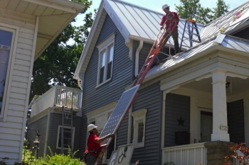 Milwaukee solar installers putting in a rooftop solar energy system on Dr. Paula Papanek's home. | Photo courtesy of Dr. Paula Papanek.
