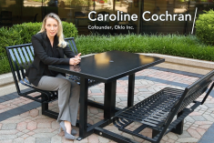 Caroline Cochran sits at a table and talks about nuclear energy.