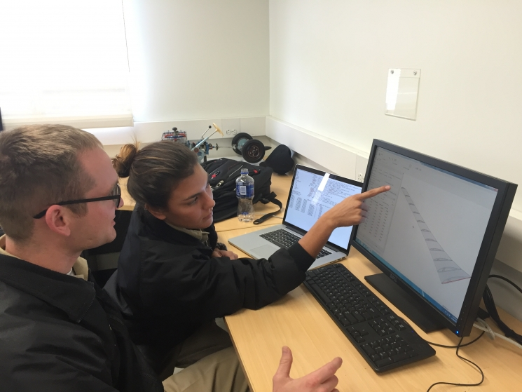 Sarah McDonald and Zach Domagala using blade design software to develop their teams turbine blades.