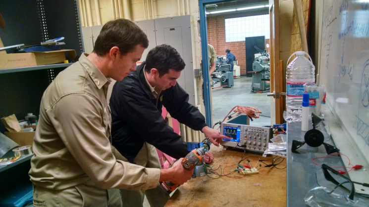 Alec Safreno and David Buckley test motors in their turbine generator selection process. They are looking for a motor with the perfect characteristics.