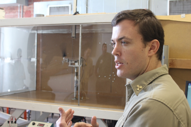 Cal Maritime Team leader David Buckley describes and demonstrates the design and operation of the teams' wind turbine in the student-built wind tunnel.