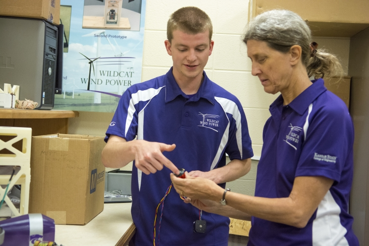 Michael Banowetz informs Ruth Douglas Miller, faculty advisor, of the team's generator selection.